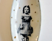small elliptical porcelain portrait bowl with underglaze drawing and gold luster