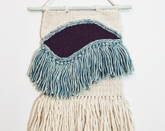 indigo and purple fringed swoop weaving | woven wall hanging
