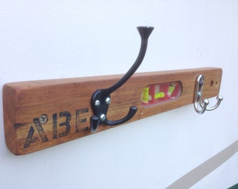 "18"" antique wood level with 2 hooks."