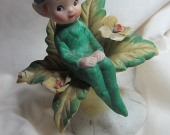 Sweet little vintage prim pixie, sitting on a flower,probably '60s