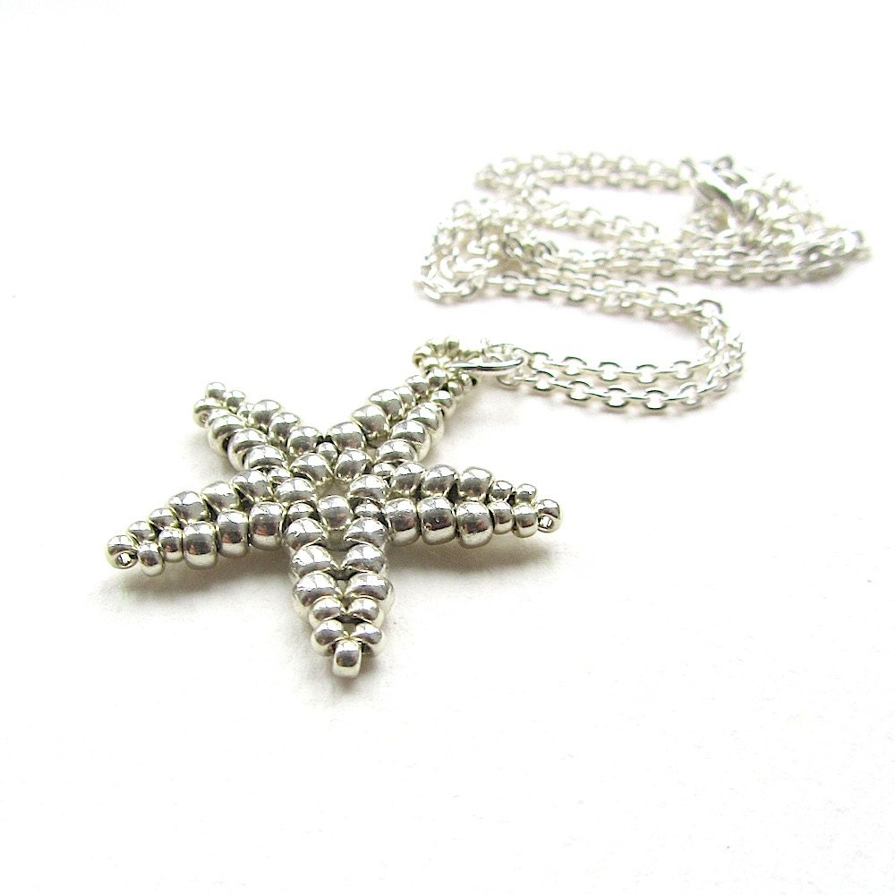 beaded starfish pendant silver coloured handstitched by