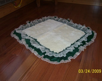 Rug size 30x44 with ruffle and lace or without. You may pick color of ruffle. You may have lace and rug color white and ecru.