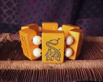 sitting dragon mah jongg bakelite bracelet Chinese symbols strategy game