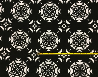 """White snowflakes on black cotton lycra knit fabric 58"""" wide"""