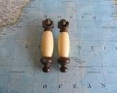 SALE! 2 lightly speckled ivory porcelain and brass metal drop pulls