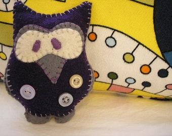 Dark purple and gray owl