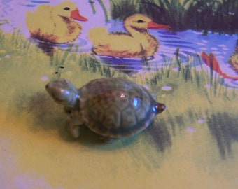 very itty bitty porcelain turtle