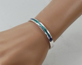 Sterling silver cuff with turquoise, malachite and lapis inlay