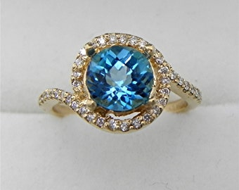 AAAA Swiss Blue Topaz 1.72 carats 7.0mm  Round Halo diamond engagement ring in 14K Yellow gold. 2109(2) MMM