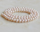 Freshwater Pearl Pastel Pink Roundish Oval 5.5mm 80 beads Full Strand