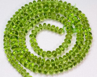 5.3MM-7.5MM Afghani Peridot Smooth Rondelle Beads 21.2 inch strand