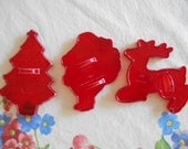 Vintage Lot of 3 red hard plastic Christmas Cookie Cutters Christmas Tree Santa Claus Reindeer