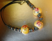 Boho vintage 70s choker necklace with a three large mustard ceramic beads and hand painted  roses.