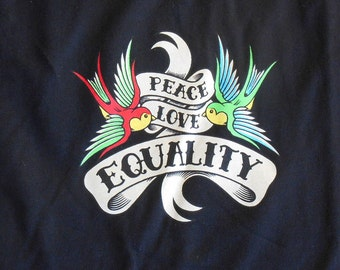 """Vintage T shirt with """"Peace love equality"""" in a tattoo style banner held by birds"""