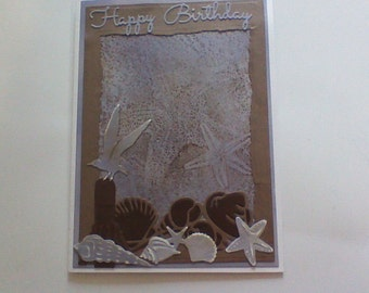 Happy Birthday Card taupe and blue withh sea shells.