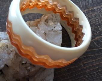 Wide two tone bangle bracelet