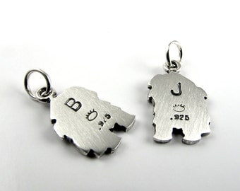 Add a stamped initial to the back of your pendant