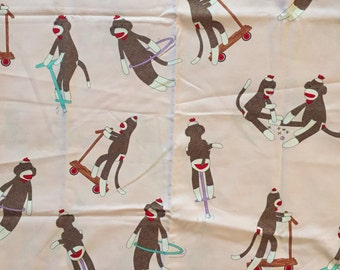 Moda Fabrics Monkey'n Around by Erin Michael PinkTossed Sock Monkey Fabric by the yard