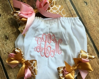 Monogramed diaper cover with matching handband.