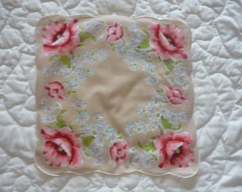Vintage handkerchief dusty rose with roses in corners and middle edges, small blue flower surrounding roses