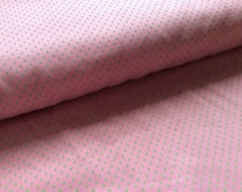 Fabric Finders' cotton twill lime dots on pink: 1/2 yard