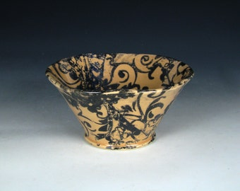 Peach Bowl with Black Flower and Spiral Pattern
