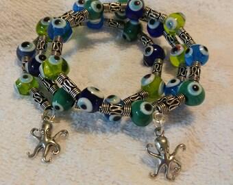 Lampwork Evil Eye memory wire wrap bracelet in Blues&Greens