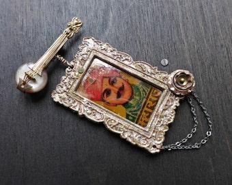Eternitarian. Rustic assemblage brooch or pendant.