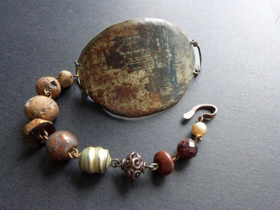 Monachopsis. Brown rustic assemblage bracelet with salvaged tin.