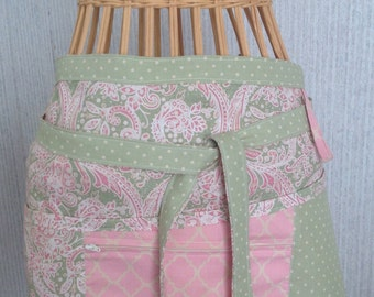 Vendor apron with zippered pocket pink and green