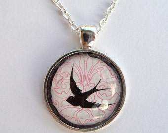 """Black dove silhouette over pink pattern under 1"""" Round Glass Cabochon Pendant with Chain"""