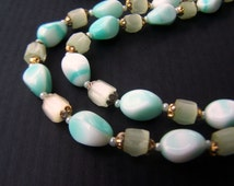 Vintage Glass Bead Necklace 30 inches long Aqua Blue Pinched Color float beads and Faceted Satina Glass Beads 1960s