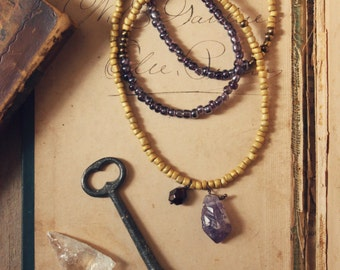 The Spellcaster Necklace No.2 | Rustic, Bohemian, Hand Beaded Glass, Amethyst and Garnet Necklace.