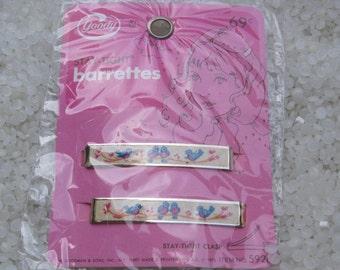 vintage barrettes  on original card NOS,sweet  bird blue
