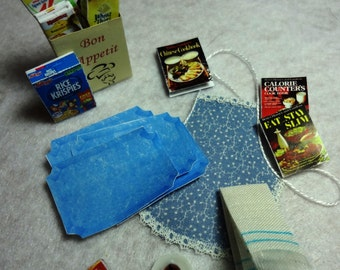 Kitchen Accessories Set with Blue Patterned Apron and Solid Blue Place Mats