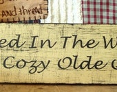 Wrapped in the warmth of a cozy olde quilt primitive wood sign