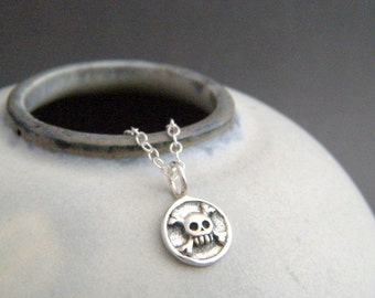 """tiny silver skull crossbones necklace. small Halloween charm. cross bones. sterling silver simple jewelry delicate pendant dainty gift 3/8"""""""