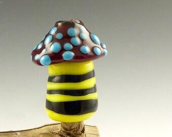 Its a buzzz magic mushroom glass bead for skinny dreadlocks