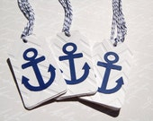 twelve navy blue anchor tags on white embossed chevron background ties with navy white bakers twine nautical party tags navy anchor gift tag
