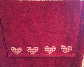 Red appliqued hand towel
