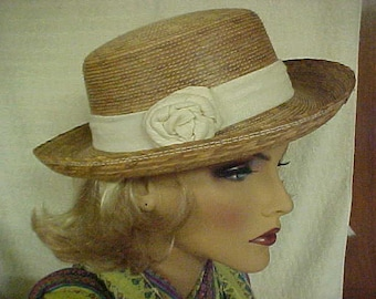 SALE  Straw hat with white linen like band and side decoration- fits 23 inches