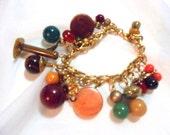 Charm Bracelet with 16 Vintage BAKELITE Beads, All Shapes