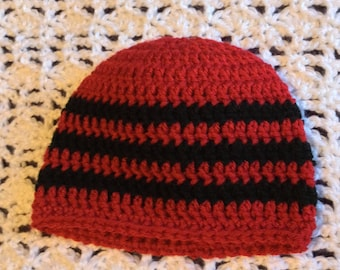 Red and black striped hat