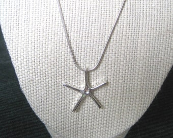 Sterling Silver Starfish on a sterling silver snake chain,18 inches long.