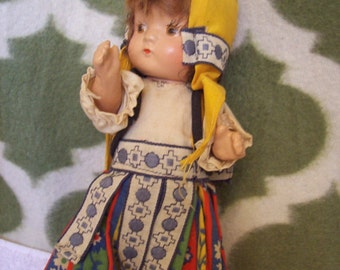 Antique Composition Norway doll, small ethnic costume tottler.