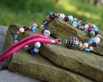 Pink Leather Tassel Necklace with Bone Focal Bead and Multi Color Stone and Crystals