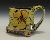 Whimsical floral design mug yellow orange red with feet