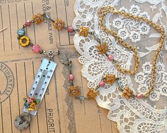 industrial floral necklace assemblage thermometer winter garden lock enamel flower