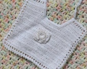 Glamorous Princess bib for baby girl is handmade crochet lace with rose and pearls