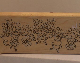5 Christmas Monkeys Swinging from the Christmas Tree Branch Rubber Stamp